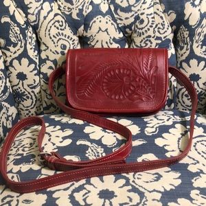 Red hand tooled small leather bag by American West